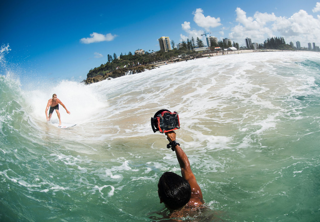 a photographer uses the Aquatech Base water housing kit to shoot a photo of Mick Fanning surfing in Australia